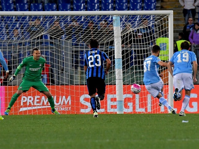 Antonio Candreva kicks to score a penalty during the Serie A match between Lazio and Inter Milan at Olympic Stadium in Rome on May 1, 2016