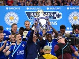 Claudio Ranieri and his Leicester City players celebrate with the Premier League trophy on May 7, 2016