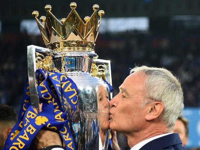 Leicester City manager Claudio Ranieri kisses the Premier League trophy on May 8, 2016