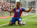 Dwight Gayle celebrates scoring during the Premier League game between Crystal Palace and Stoke City on May 7, 2016