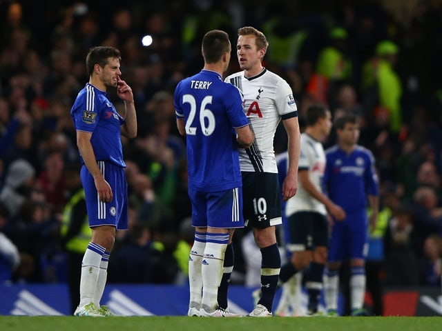 A dejected Harry Kane of Tottenham Hotspur shakes hands with John Terry and Cesar Azpilicueta of Chelsea following the 2-2 draw on May 02, 2016