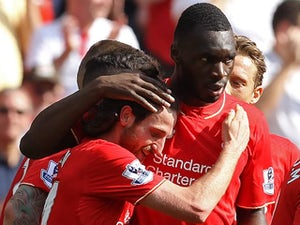 Joe Allen celebrates with Christian Benteke during the Premier League game between Liverpool and Watford on May 8, 2016
