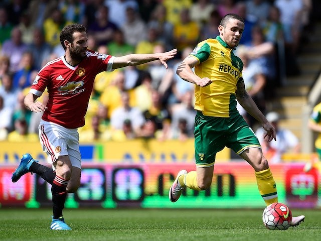 Juan Mata and Robbie Brady in action during the Premier League game between Norwich City and Manchester United on May 7, 2016