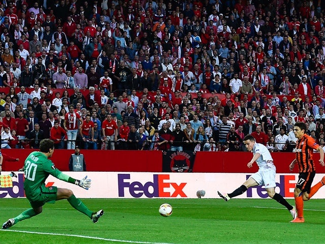Kevin Gameiro of Sevilla scores the opening goal past Maksym Malyshev and Andriy Pyatov of Shakhtar Donetsk during the UEFA Europa League semi-final second leg on May 5, 2016