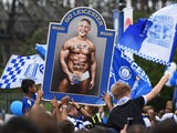A topless Gary Lineker is paraded by Leicester City fans on May 7, 2016