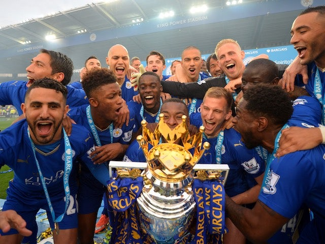 Leicester City players celebrate with the Premier League trophy on May 8, 2016
