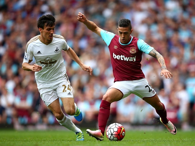 Manuel Lanzini and Jack Cork in action during the Premier League match between West Ham United and Swansea City on May 7, 2016