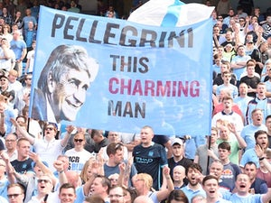 Manchester City fans hold up a sign for Manuel Pellegrini on May 8, 2016