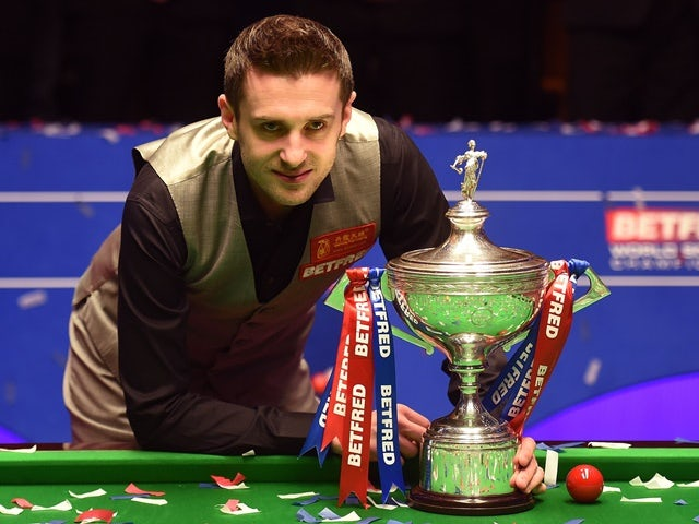 Mark Selby poses with the trophy after beating Ding Junhui in the final of the World Snooker Championship at the Crucible on May 2, 2016