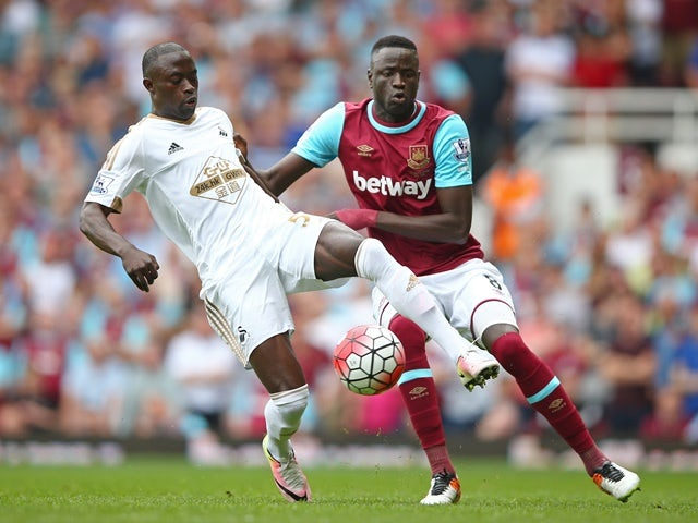 Modou Barrow and Cheikhou Kouyate in action during the Premier League match between West Ham United and Swansea City on May 7, 2016
