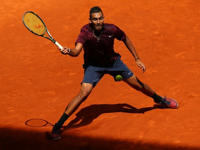 Nick Kyrgios plays a forehand during his straight-sets victory against Stanislas Wawrinka in their second-round match during day five of the Madrid Open on May 04, 2016