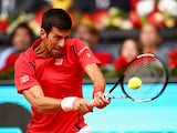 Novak Djokovic plays a backhand against Roberto Bautista Agut in their third-round match during day six of the Mutua Madrid Open on May 5, 2016