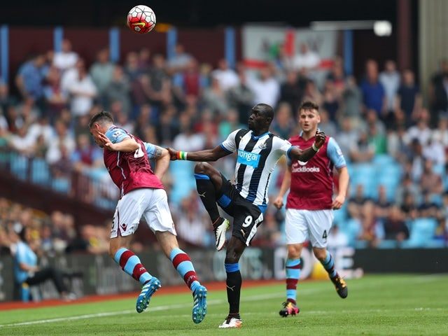 Papiss Cisse and Ciaran Clark in action during the Premier League match between Aston Villa and Newcastle United on May 7, 2016