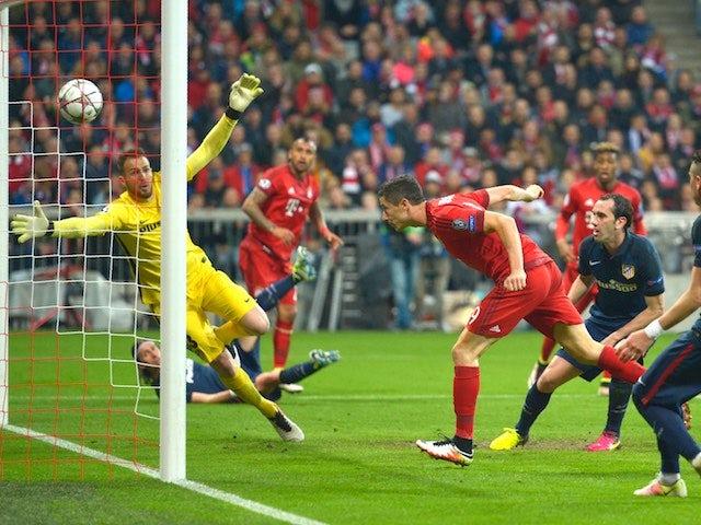 Robert Lewandowski scores Bayern Munich's second goal in the Champions League semi-final second leg against Atletico Madrid on May 3, 2016