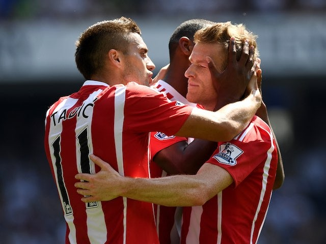 Steven Davis celebrates with Dusan Tadic during the Premier League game between Tottenham Hotspur and Southampton on May 8, 2016