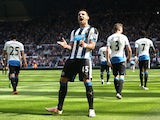 Aleksandar Mitrovic celebrates scoring during the Premier League game between Newcastle United and Tottenham Hotspur on May 15, 2016