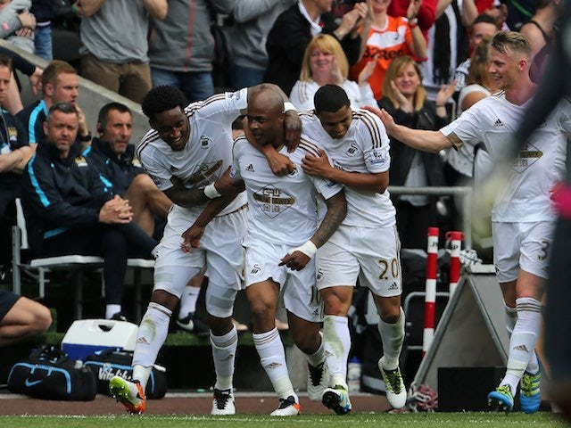 Andre Ayew celebrates scoring during the Premier League game between Swansea City and Manchester City on May 15, 2016