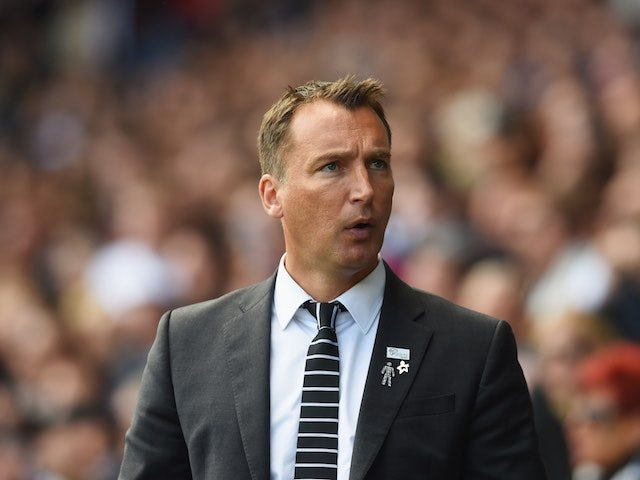 A badge-laden Darren Wassall watches on during the Championship playoff semi-final between Derby County and Hull City on May 14, 2016