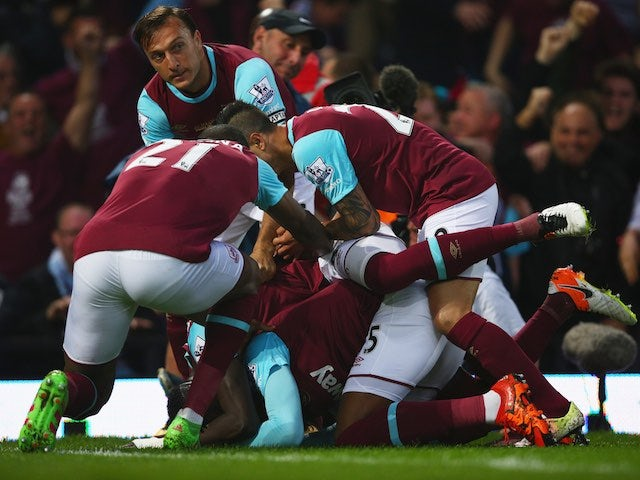 Diafra Sakho is quite literally violated from all angles after scoring during the Premier League game between West Ham United and Manchester United on May 10, 2016