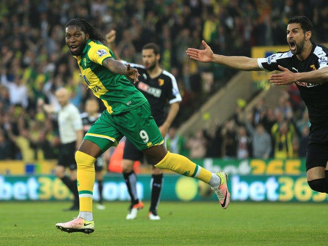 Norwich City striker Dieumerci 'no, thank you' Mbokani is chased by a rabid Miguel Britos after scoring against Watford on May 11, 2016