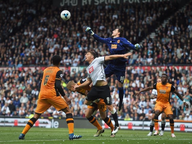 Eldin Jakupovic punches clear a Chris Martin shot during the Championship playoff semi-final between Derby County and Hull City on May 14, 2016