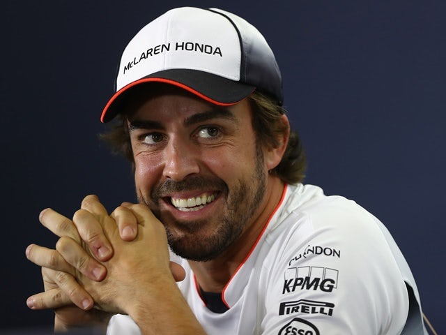 Little Fernando Alonso of McLaren laughs evilly in the drivers press conference during previews to the Spanish Formula One Grand Prix at Circuit de Catalunya on May 12, 2016