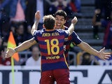 Luis Suarez celebrates opening the scoring with Jordi Alba during the La Liga game between Granada and Barcelona on May 14, 2016