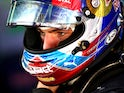 Max Verstappen of Red Bull Racing puts his helmet on in the garage during previews to the Spanish Formula One Grand Prix at Circuit de Catalunya on May 12, 2016