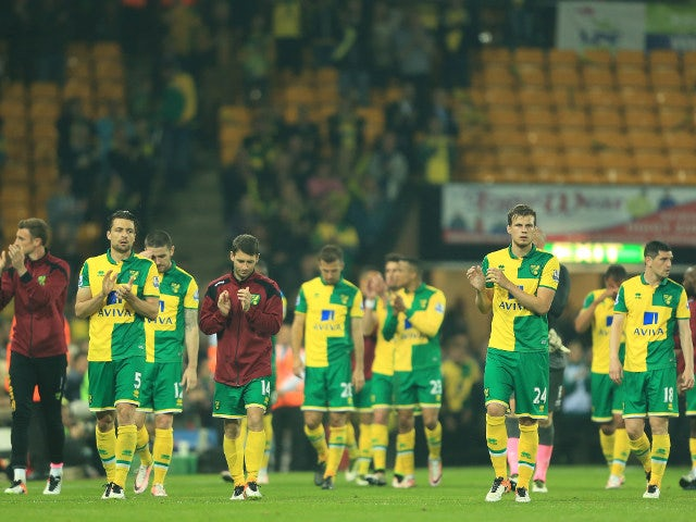Norwich City players look distraught as they contemplate having to face lowly Ipswich Town and Wolverhampton Wanderers in the Championship next season following their relegation from the Premier League