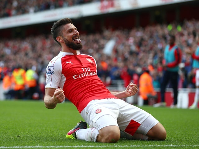 Olivier Giroud celebrates scoring during the Premier League game between Arsenal and Aston Villa on May 15, 2016