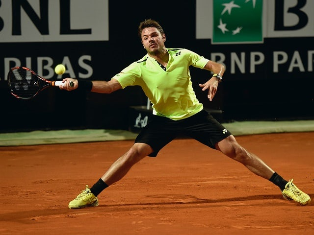 Stanislas Wawrinka plays a forehand in his match against Benoit Paire on day three of the Rome Open on May 10, 2016