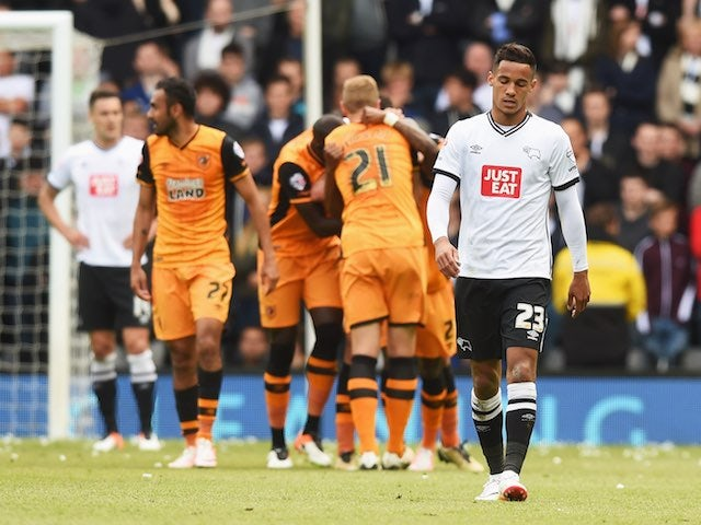 Tom Ince looks downbeat as Hull players celebrate their second goal during the Championship playoff semi-final between Derby County and Hull City on May 14, 2016