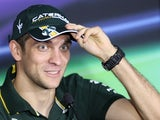 Vitaly Petrov speaks during a press conference at the Yas Marina circuit on November 1, 2012