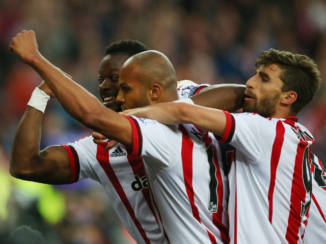 Sunderland's Younes Kaboul leads the celebrations on the way to a 3-0 win over Everton on May 11, 2016 that secured his side's Premier League survival