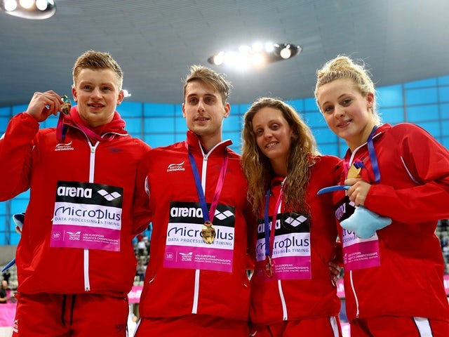 Great Britain's Adam Peaty, Chris Walker-Hebborn, Francesca Halsall and Siobhan-Marie O'Connor pose with their gold medals after winning the mixed 4x100m medley Final on day nine of the 33rd LEN European Swimming Championships 2016 at the London Aquatics