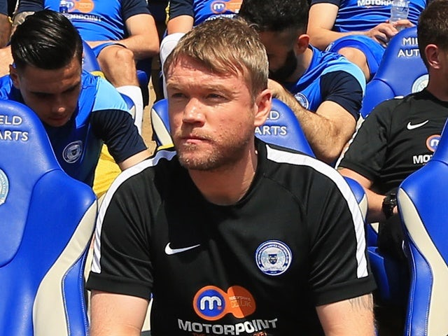 Grant McCann looks on from the bench prior to the League One match between Peterborough United and Blackpoo on May 8, 2016