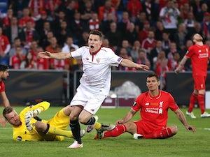 Sevilla win third straight EL crown