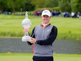 Rory McIlroy poses with the trophy after his three-shot victory in the Irish Open on May 22, 2016