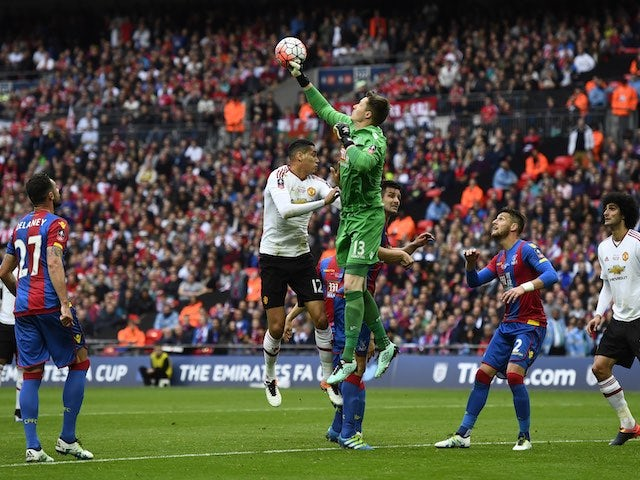 Wayne Hennessey punches clear a shot from Chris Smalling during the FA Cup final between Crystal Palace and Manchester United on May 21, 2016