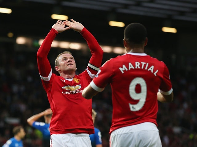 Wayne Rooney of Manchester United celebrates with Anthony Martial as he scores their first goal against Bournemouth at Old Trafford on May 17, 2016
