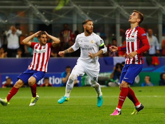 Antoine Griezmann reacts to missing a pen during the Champions League final between Real Madrid and Atletico Madrid on May 28, 2016