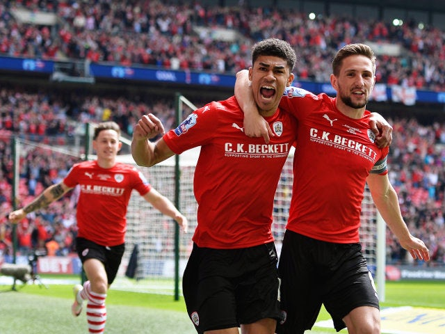 Barnsley's Ashley Fletcher celebrates scoring the opening goal during his side's League One playoff final against Millwall at Wembley on May 29, 2016