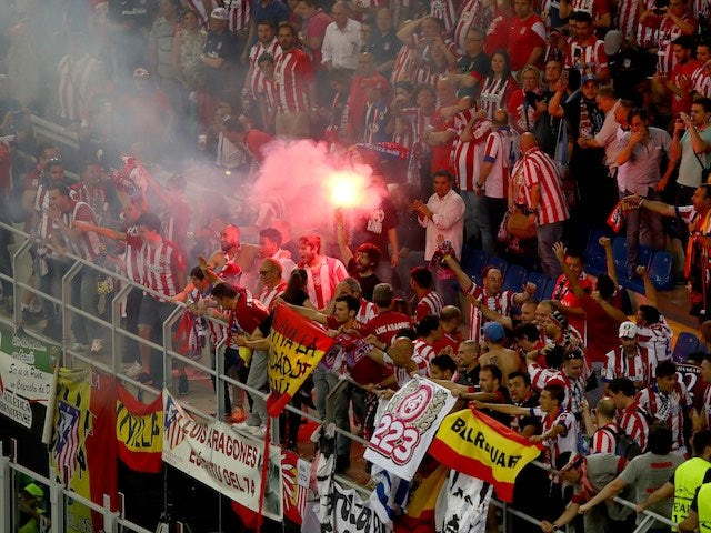 Atletico fans let off flares during the Champions League final between Real Madrid and Atletico Madrid on May 28, 2016