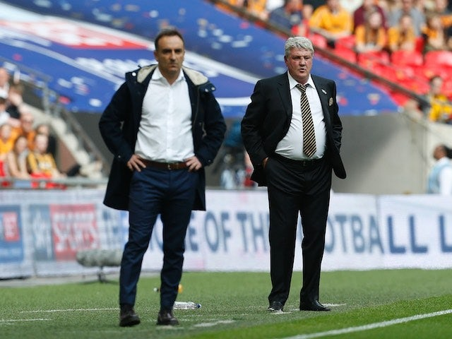 Carlos Carvalhal and Steve Bruce watch on during the Championship playoff final between Hull City and Sheffield Wednesday on May 28, 2016