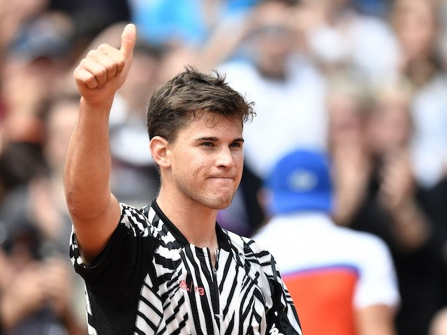 Dominic Thiem celebrates victory in the second round of the French Open on May 26, 2016