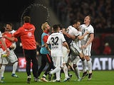 Eintracht Frankfurt's players celebrate after the Bundesliga second-leg relegation football match against Nuremberg on May 23, 2016