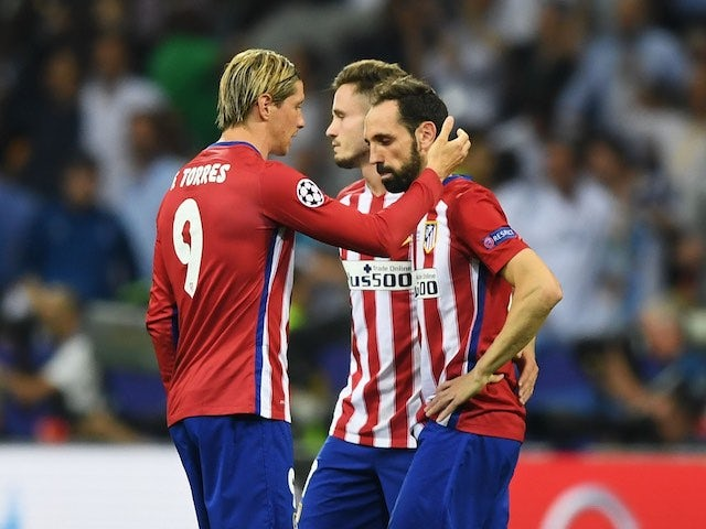 Fernando Torres consoles Juanfran after the Champions League final between Real Madrid and Atletico Madrid on May 28, 2016