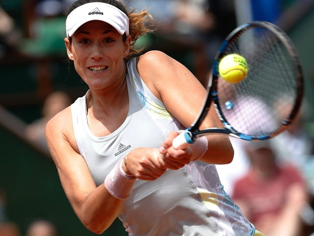 Garbine Muguruza returns the ball to Myrtille Georges during their women's second-round match at the French Open on May 25, 2016