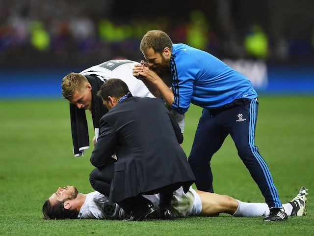 Gareth Bale receives treatment for cramp during the Champions League final between Real Madrid and Atletico Madrid on May 28, 2016