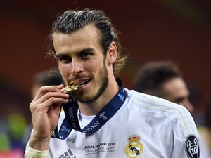 Gareth Bale poses with his winners' medal after the Champions League final between Real Madrid and Atletico Madrid on May 28, 2016